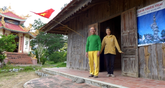 This lovely couple was so excited to have us stop by the temple they tended that they took a few minutes to change into their hosting duds. They offered us tea and bananas and the blessings of Buddha before we headed back out on the road, but not before we met their son who was on his way back to Saigon where he studied English.