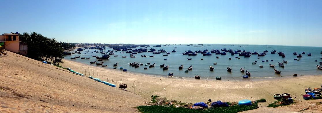 Fishing boats anchored off the coast near Mui Ne.