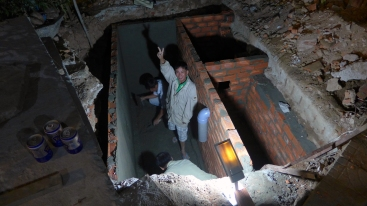 Outside the hotel in Phan Rang-Thap Cham, construction workers toiled in the dark, digging what appeared to be some kind of cellar or plumbing facility. They asked us to by them beers and we obliged.