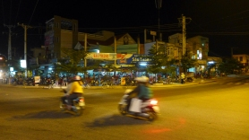 At a lively corner restaurant near the Phan Rang-Thap Cham bus station we found some passable pho, a bunch of locals watching an English Premier League football match, and a deaf waitress who we flattered with our attentions.