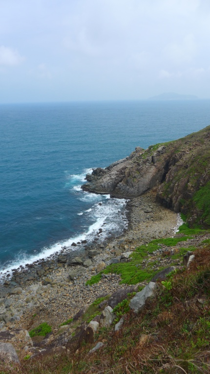 Much of Con Son's coastline — we not tapering off to secluded beaches — dropped off sharply into the crashing blue waves below.