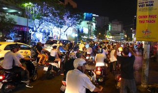 The motorbikes travel in packs in Saigon. Individual riders will strike out on their own — often against oncoming traffic — but for the most part the herd sticks together.