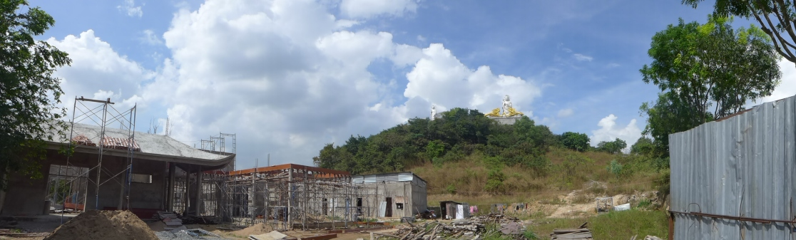 At a Buddhist temple in Thu Duc, construction was underway on a new building at the base of the hill — or, in the local parlance, a mountain. Most of the temples I've visited so far have been in a seemingly continuous state of renovation and expansion. Though their monks are poor in personal riches, many of the temples aren't wanting for wealth.