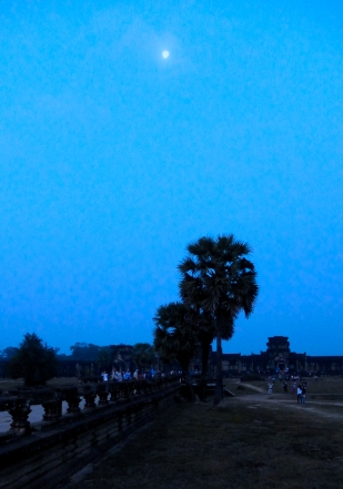 The moon was still well above the horizon when we arrived at Angkor Wat, the largest of the Khmer temple complexes.