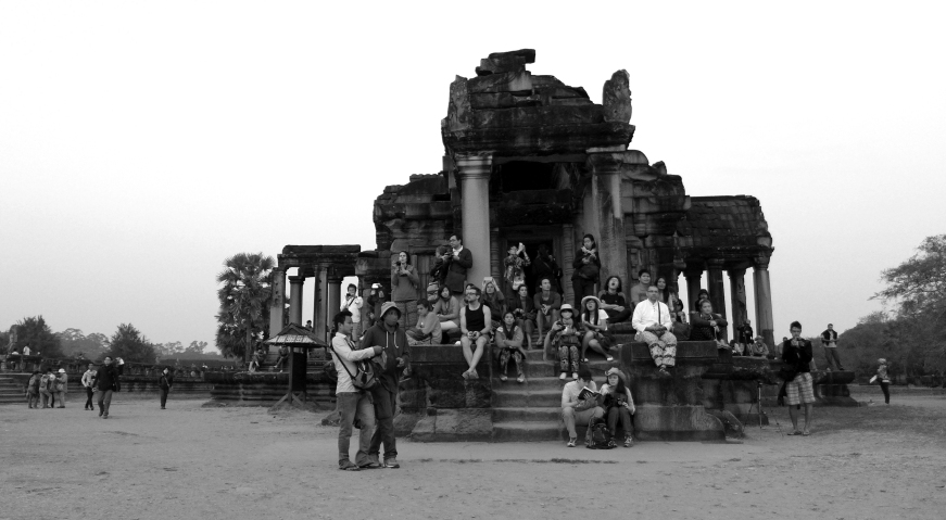 Revelers await the rising sun at Angkor Wat. Even though we arrived early, there were still hundreds of people already waiting to explore the massive ruins.