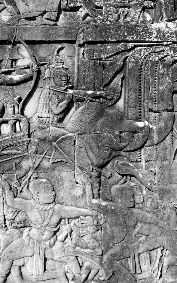 Battle scenes — spear-and-bow-wielding warriors, elephant riders, chariots — were a popular motif.