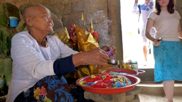 A woman offers blessings and luck bracelets (and accepts donations), in an alcove amid the ruins of Ta Prohm. Burning joss sticks, her shaved head, and the various offerings that surrounded her made me think she probably wasn't a Mormon.