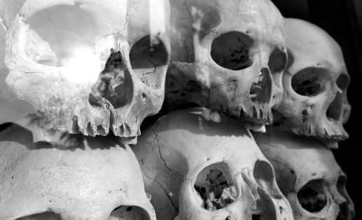 An unsettling collection of skulls stacked on shelves inside the memorial stupa at Choeung Ek.