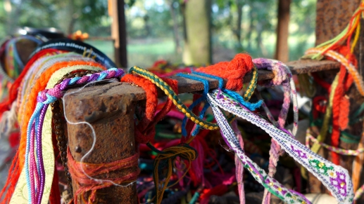 These bracelets left for the young victims of the Khmer Rouge were the one — literal — bright spot at Choeung Ek.