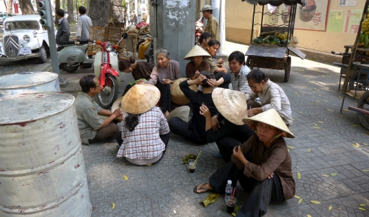 Local extras on a coffee break, probably wondering how much less they were getting paid than the geared-up foreigners.